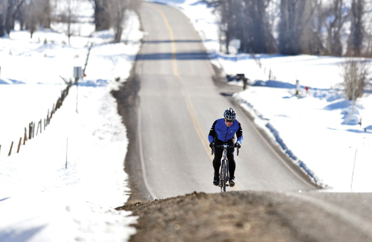 Cyclist Blake Chilsom took advantage of Monday's warm weather to venture out onto 20-mile road for an afternoon ride.