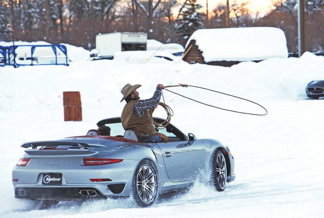 Top Gear host Tanner Foust drives a Porsche 911 Turbo through a barrel course Tuesday at the Brent Romick Rodeo Arena as a cowboy prepares to try and rope a dummy steer. Steamboat will be prominently featured in an upcoming episode of Top Gear, a History Channel show in which the hosts perform stunts and show off cars.