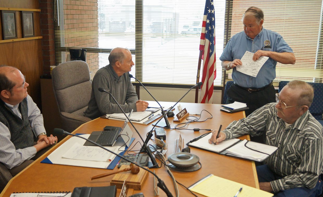 American Legion Post 62 Adjutant Brian Baxter and Commander Ed Wilkinson discuss the future of their post with the Board of Moffat County Commissioners Tuesday morning.