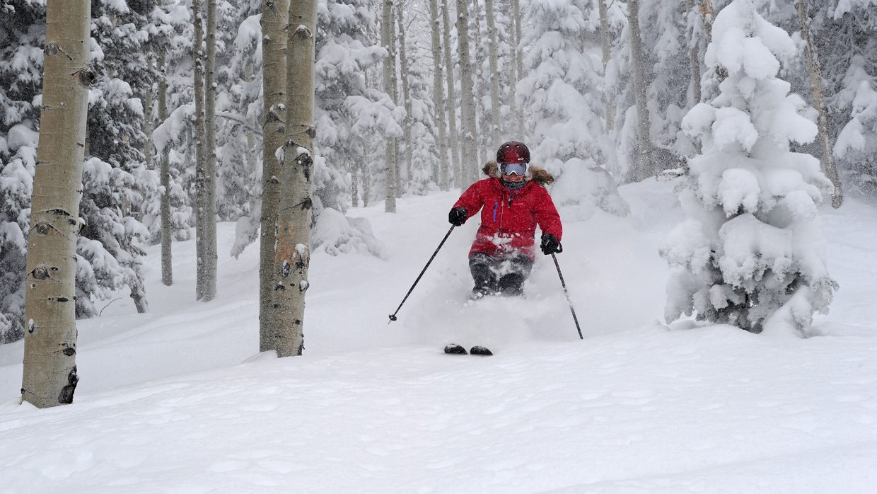 Audrey Williams floats through the aspen trees at Steamboat Ski Area Jan. 25. The ski area reported that the month's snowfall at the summit of Storm Peak had reached 102 inches.