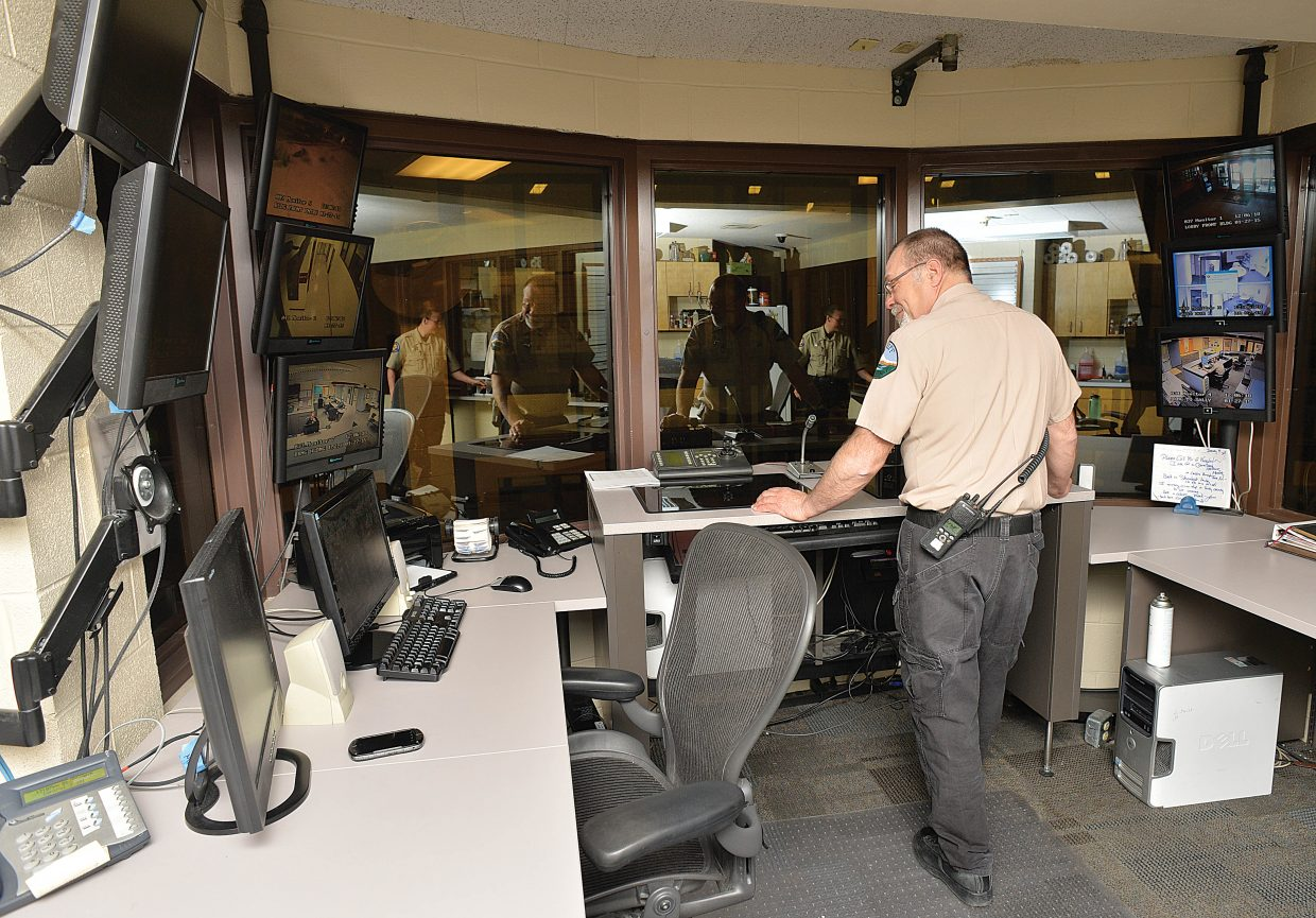 Routt County Jail Deputy Dave Schulz monitors surveillance equipment for the command center at the Routt County Jail.