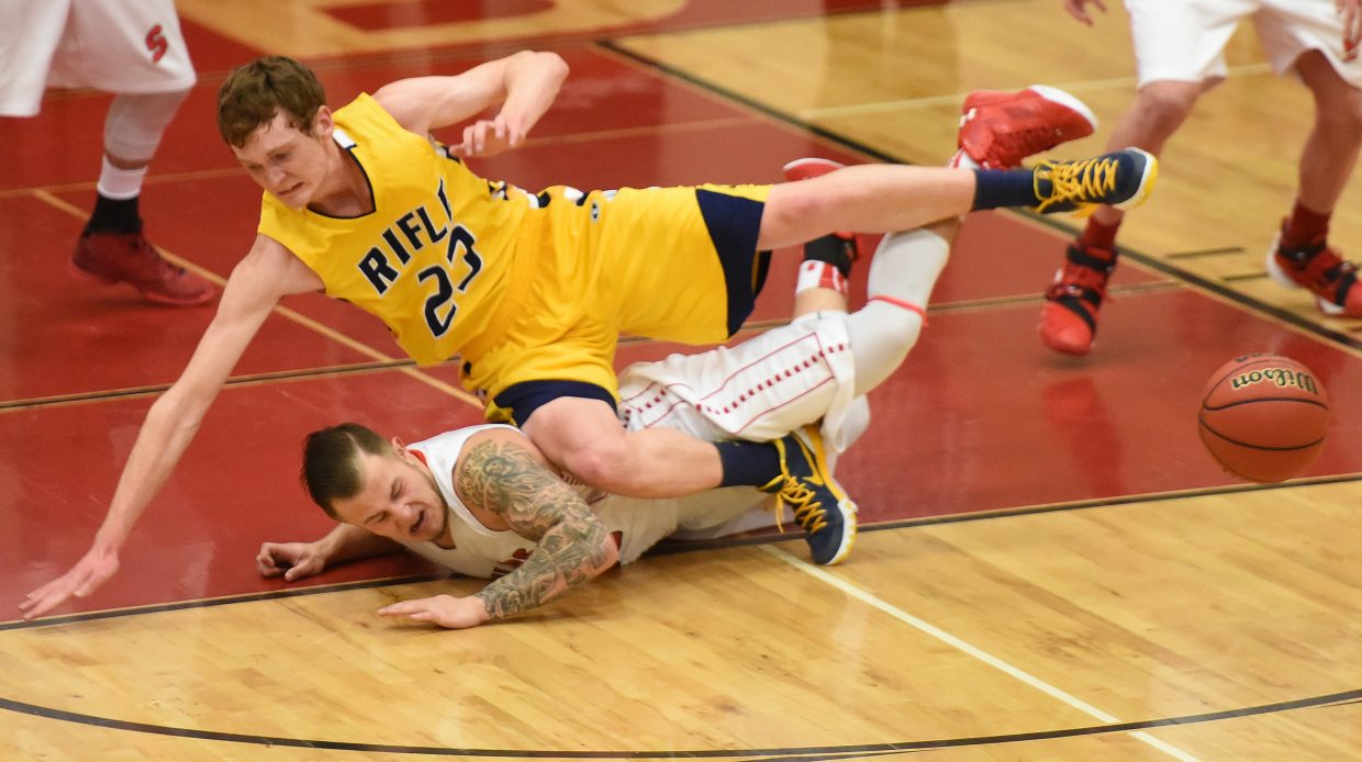 Steamboat senior Zach Holm hits the floor and gets piled on while trying to track down a loose ball Tuesday.