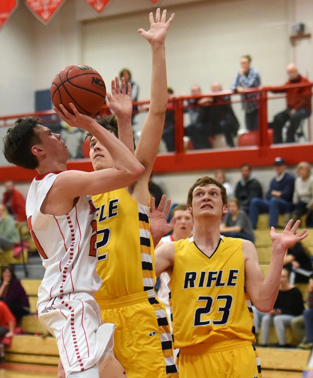 Steamboat senior John Zalesky tries to get a shot up against Rifle on Tuesday.