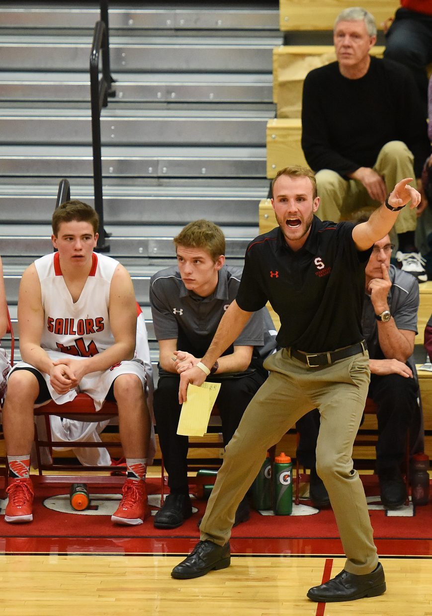 Steamboat boys coach Mike Vandahl sends orders in for his players Tuesday against Rifle.