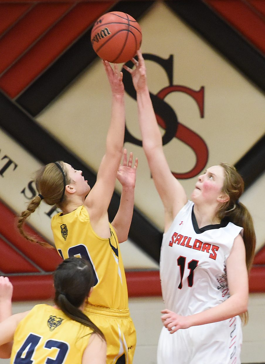 Steamboat Springs senior Annie Osbourn gets a block against Rifle on Tuesday. The Sailors came away with possession on that play, but wresting the ball from the Bears was a challenge throughout the game.