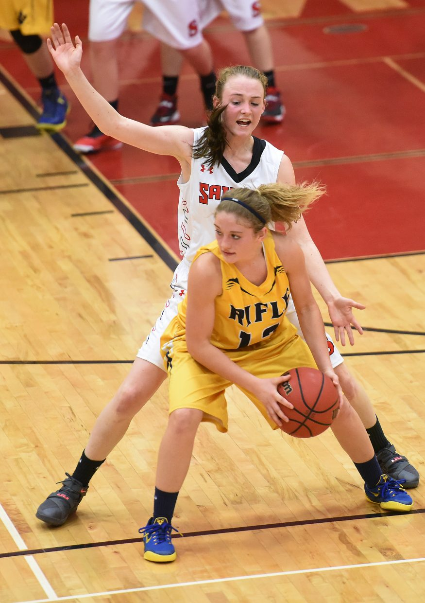 Steamboat junior Raya Duryea pours on the defense Tuesday against Rifle.