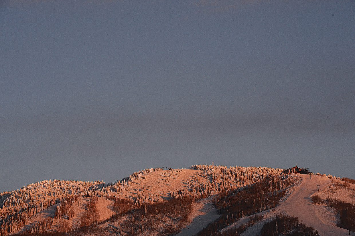 The warmth of the late afternoon light falls on the slopes of the Steamboat Ski Area late Tuesday afternoon.