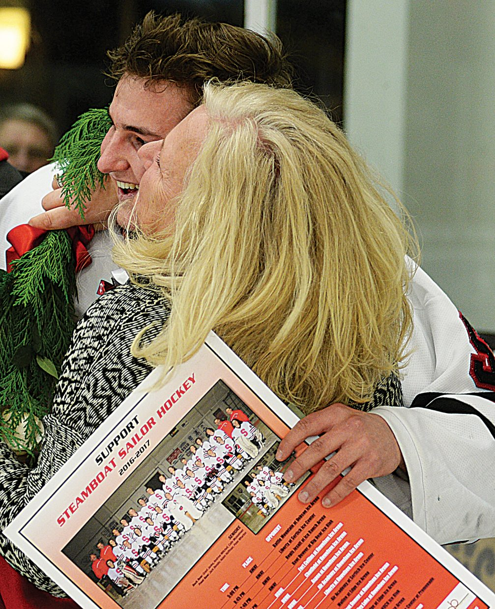 Steamboat Springs hockey player Peter Wharton hugs his mother at senior night ceremonies, held during Friday's game between Steamboat and Kent Denver. The game ended in a 3-3 tie.