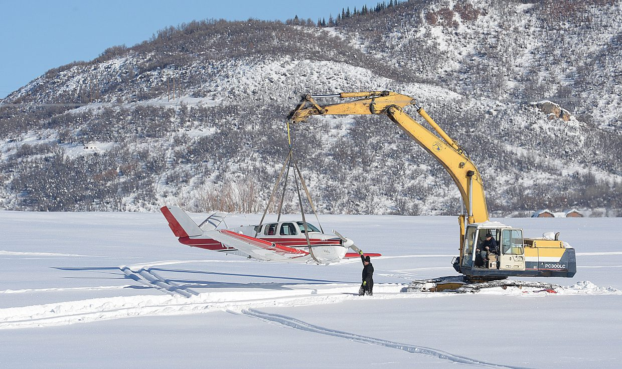 A representative of Beegles Aircraft Service guides a plane as it is walked out of a meadow just north of the Steamboat Springs Airport by an excavator driven by Tim Scopac of Native Excavating Thursday morning. The pilot reported the plane lost power after taking off, and she was able to make a hard landing in the meadow, which is located along Routt County Road 44 about one mile from Routt County Road 129. The plane spent several days in the field while the owners waited for personnel from Beegles Aircraft Services, a company that specializes in recovery of planes, to arrive and remove the plane. The plane was moved to the Steamboat Springs Aiport where FAA representatives will check the plane for mechanical issues and investigate what may have led to last Friday's incident. Officials will also deem whether the crash was an incident or an accident. The plane will also be checked out for fuel leaks and other mechanical issues.