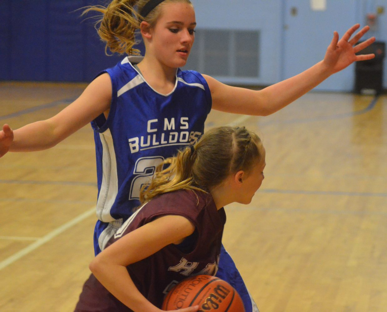 Craig Middle School's Payton Voloshin provides intimidating defense during the eighth-graders' Thursday game against Soroco. The Bulldogs won, 42-22.