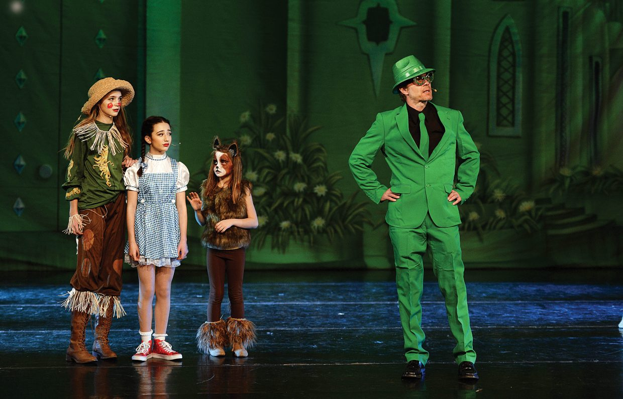Todd Danielson, The Wiz, rehearses a scene with Allison Famulare (scarecrow), Jolie Waldman (Dorothy) and Soleil Nelson (Toto) during a dress rehearsal for The Wiz Wednesday evening. Members if Elevation Dance Studio will bring the show to the stage at the Steamboat Springs High School this weekend with 6 p.m. performances Friday and Saturday evening.