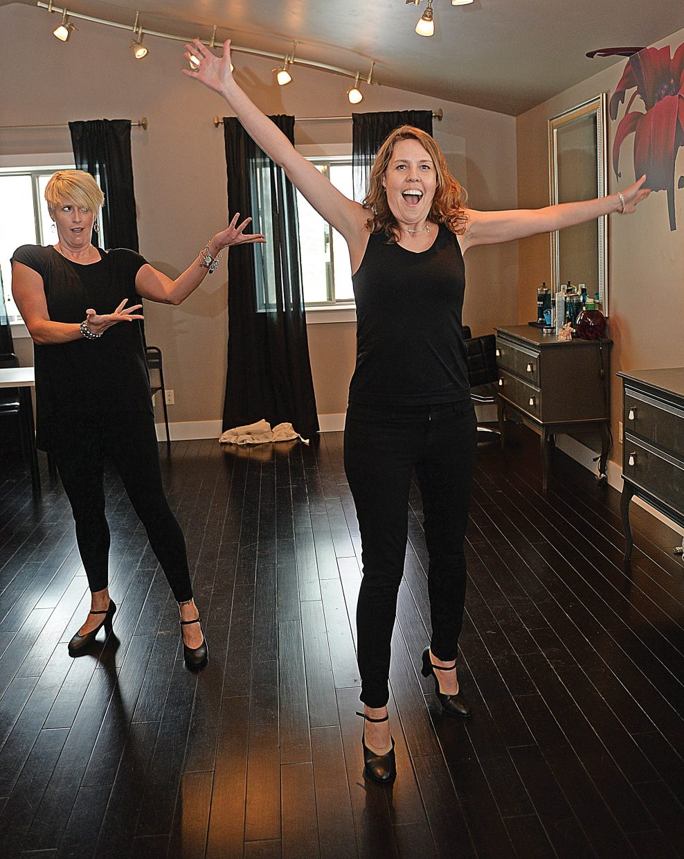 Dancers Kathryn Pedersen, front, and Andrea Kortas work on their routine for this year's Steamboat Dancing with the Stars fundraiser.
