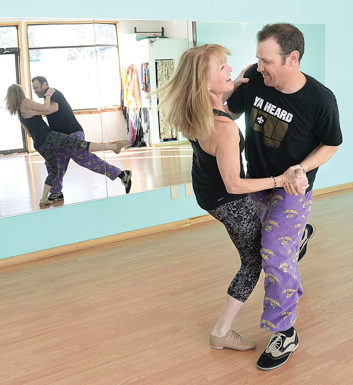 Deb Curd and Harris Greene work on their dance routine for the annual Steamboat Dancing with the Stars fundraiser.