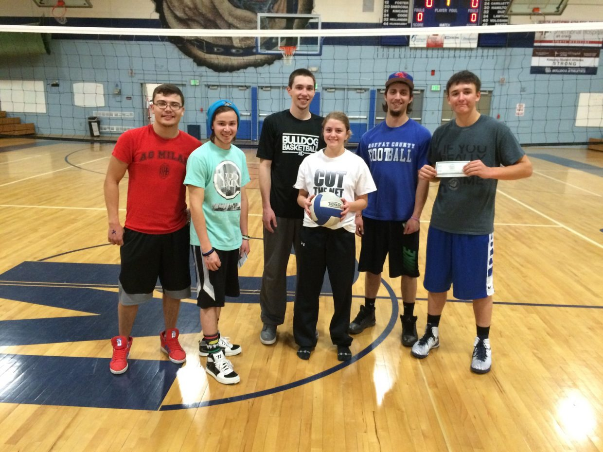 From left, Party in the Back team members Jesus Duarte, Brodey Gutierrez, Dylan Kincade, Leah Camilletti and Eli Simpson smile as teammate Dusty Taylor holds up Spree Bucks won during last week's volleyball tournament as part of Fifth Quarter activities hosted by Bear River Young Life and Grand Futures Prevention Coalition. Another Fifth Quarter event takes place Friday night following the Moffat County High School basketball games, with a bowling party at Thunder Rolls Bowling Center. The cost for high school students is $5 for two games and food.