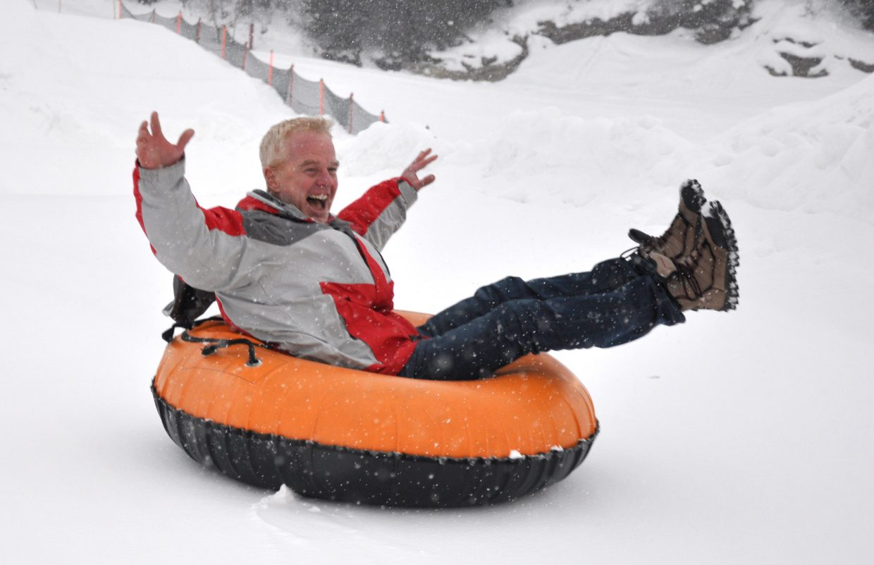 John Overstreet, the city's new Director of Parks, Open Space and Recreational Services, gives tubing a try Wednesday at Howelsen Hill for an action portrait. Overstreet brings to Steamboat more than 25 years of experience in parks and recreation, and he looks forward to bringing his family here.
