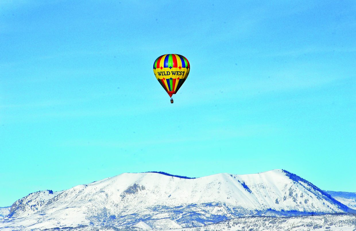 A hot air balloon floats above Sleeping Giant on a clear day in Steamboat Springs.