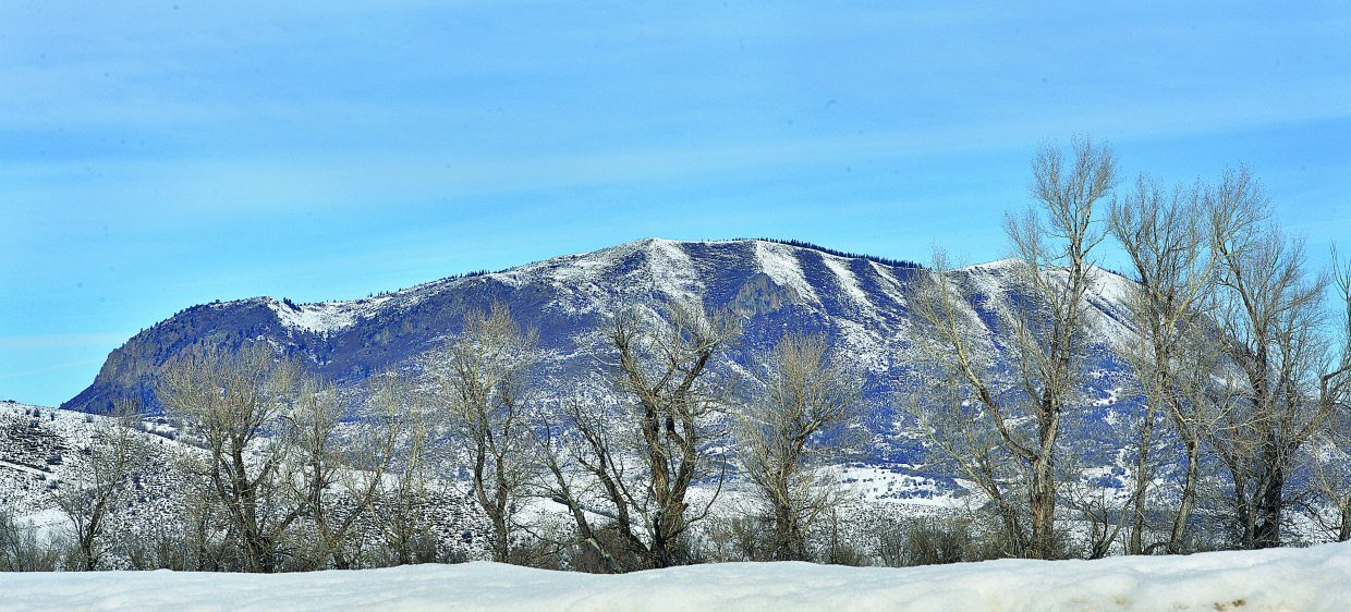 Sleeping Giant hides behind some trees Thursday just off of Routt County Road 42 near Steamboat Springs.