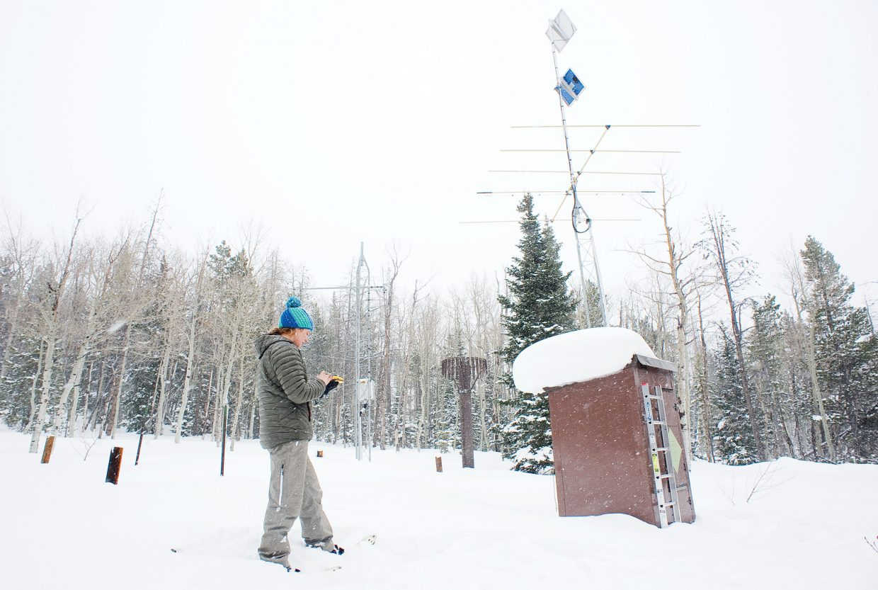 Snow Surveyor Christine Shook uses a GPS device to mark the location of a SNOWTEL station in Northern Routt County. The SNOWTEL stations measure the amount of snow and water content and send the information to the state office where it is recorded and made public on the Internet.