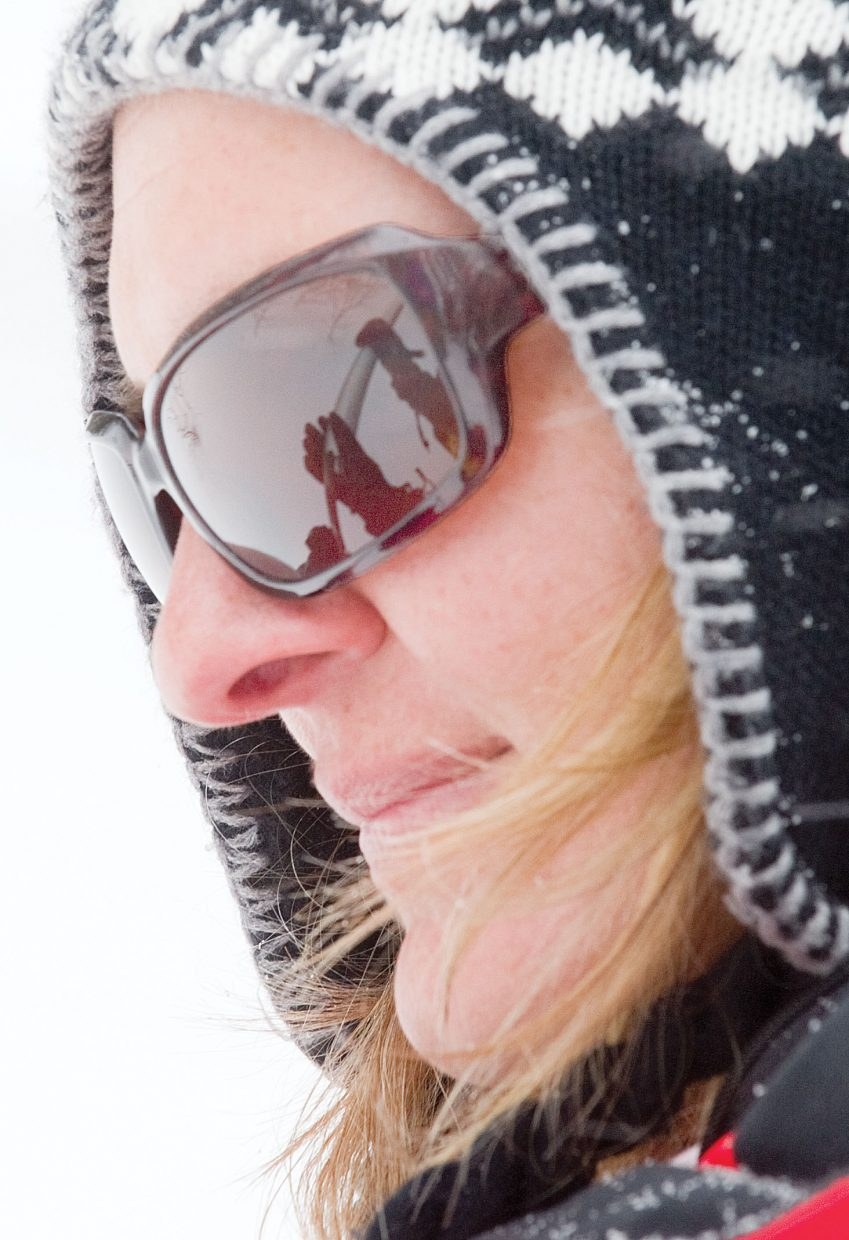 A special tube designed to measure snow depth and water content is reflected in the sunglasses of Lori Jazwick, the District Conservationist in the Steamboat Springs NRCS Field Office, while measuring the water content of a snow sample in Northern Routt County.