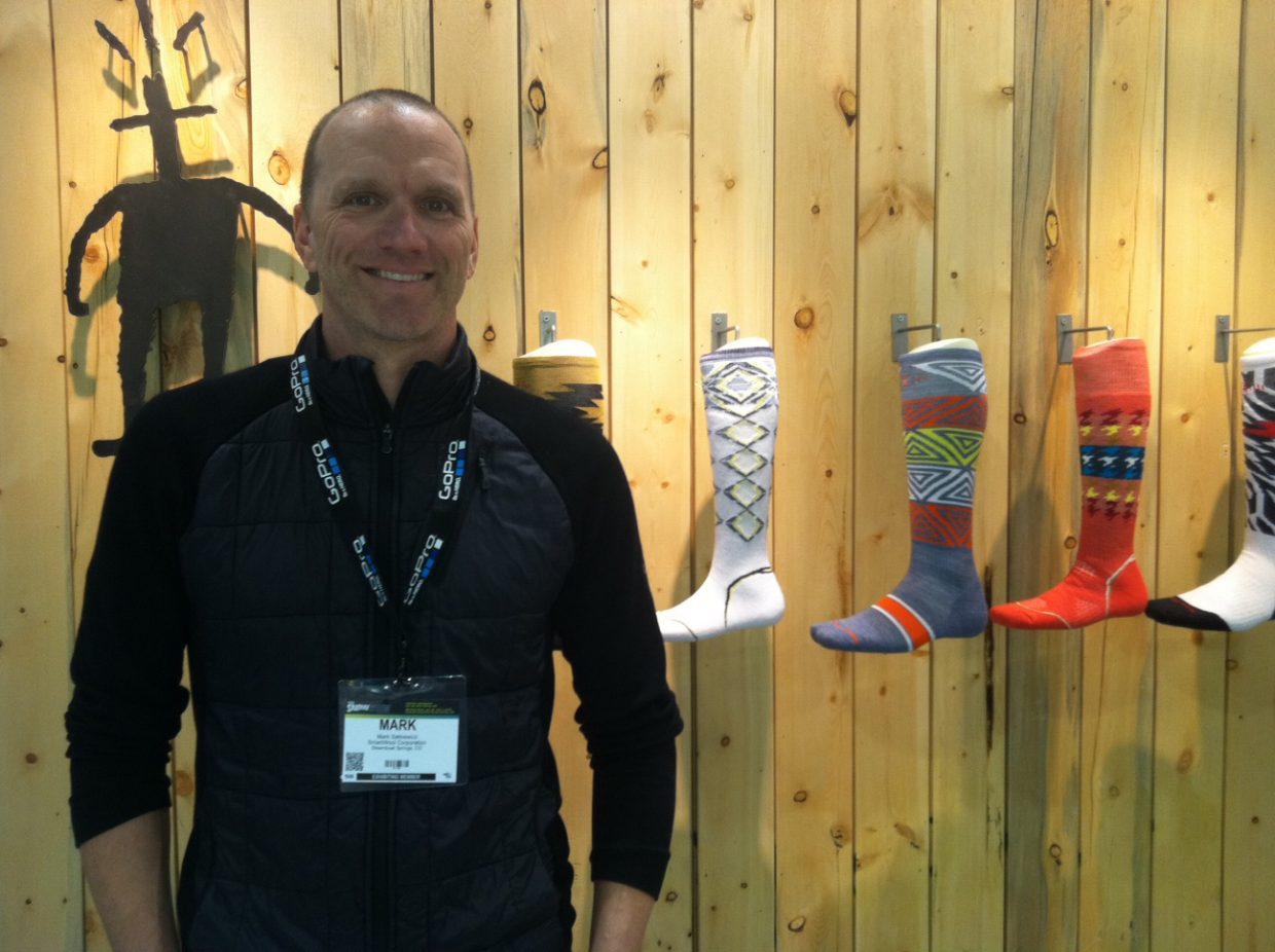 SmartWool's Mark Satkiewicz shows off products at the Snowsports Industries America Snow Show in Denver this weekend.