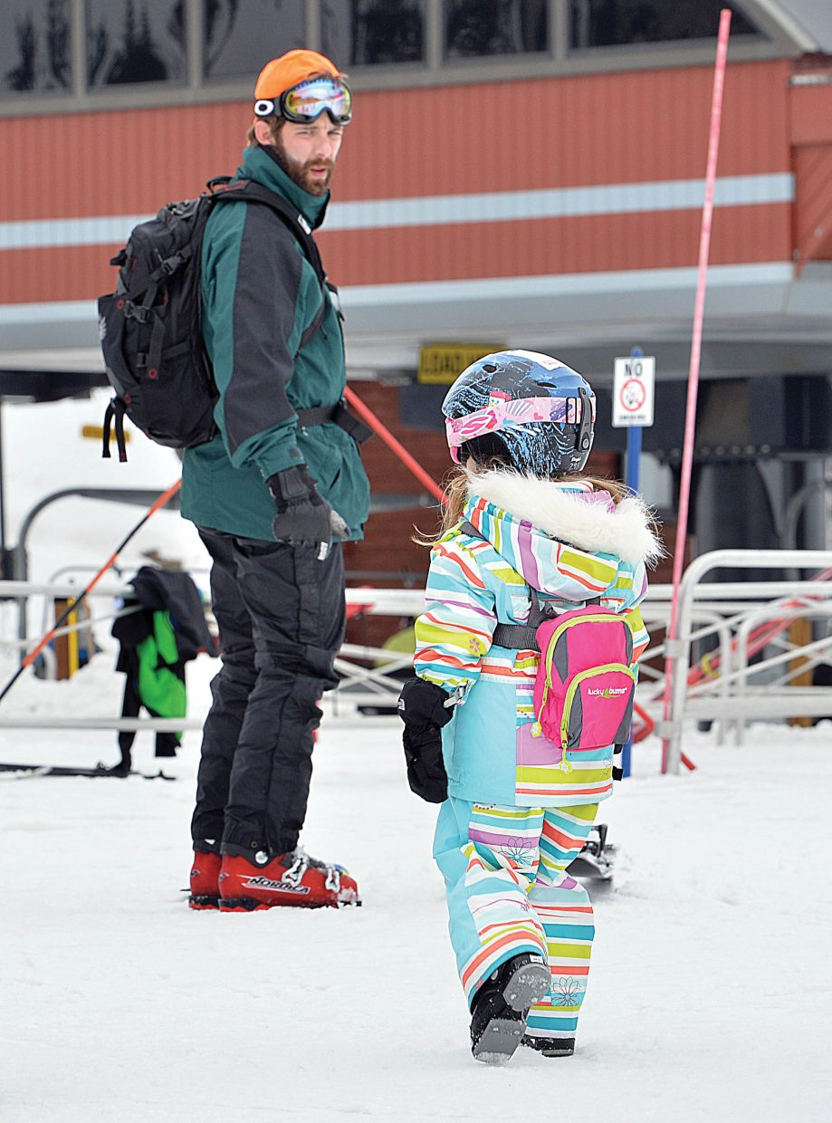 Andrew Williams waits for his daughter Mary Carlisle, 5, to catch up while skiing Friday at Steamboat Ski Area. The Williams family was visiting Steamboat Springs from Mobile, Alabama.