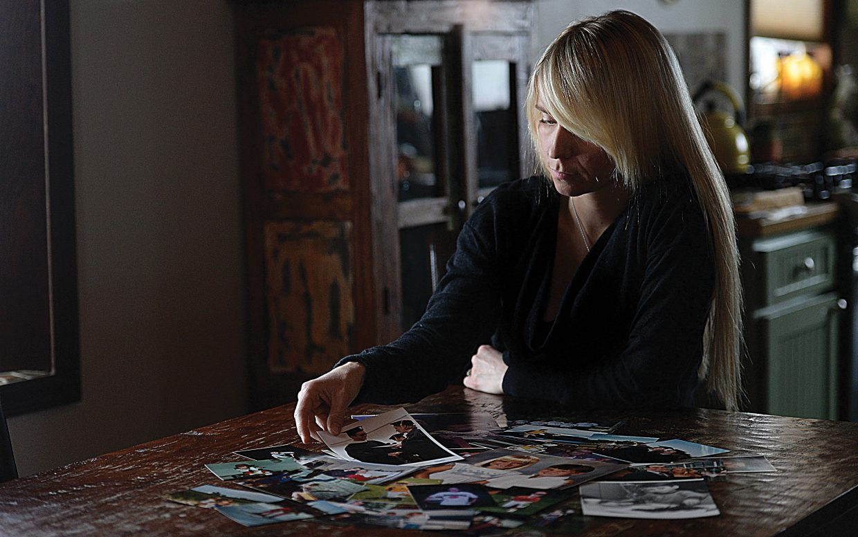 Mara Rhodes sorts through photographs of her brother Mark, who died from an accidental opiate overdose in the fall of 2014. In the wake of her brother's death, Rhodes is helping lead a community effort in Steamboat Springs and Routt County to raise awareness about the dangers of prescription pills and heroin use.