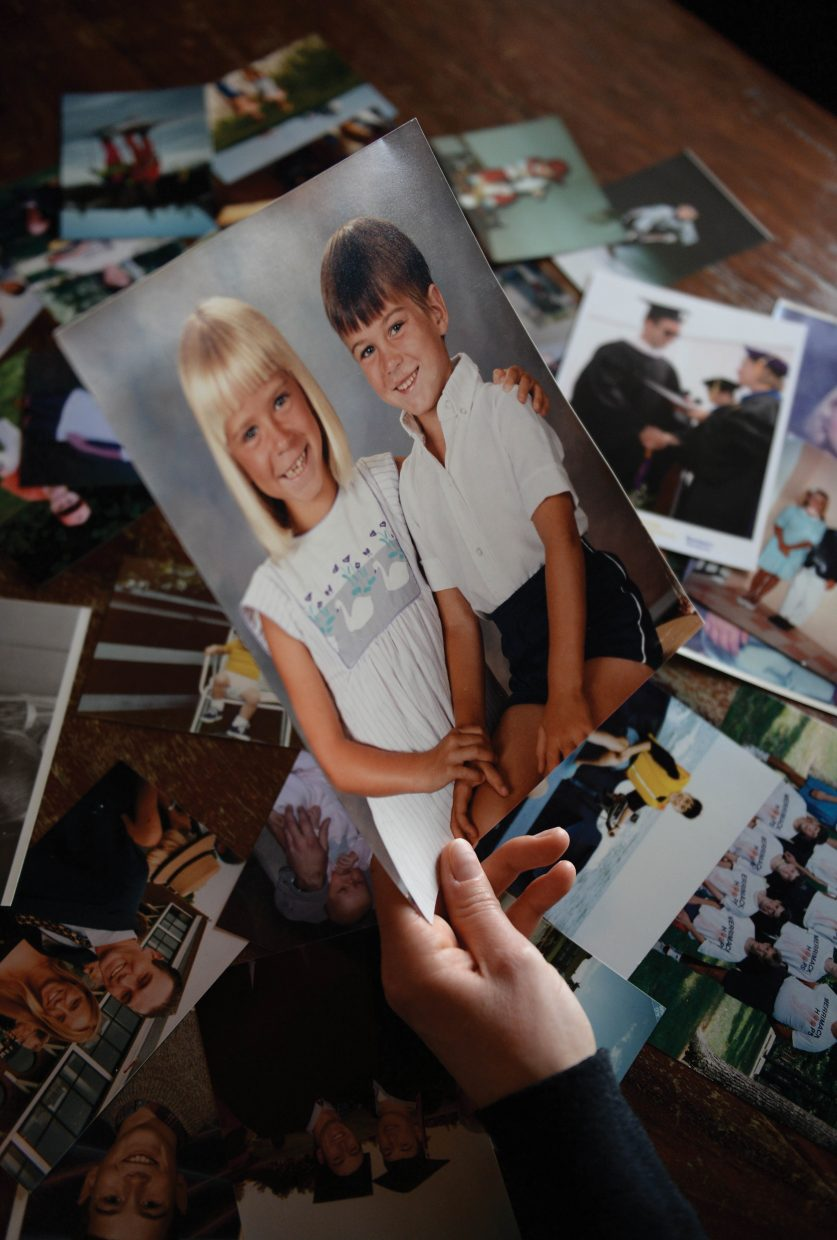 Mara Rhodes holds a photograph of she and her brother Mark taken when they were young children. Rhodes was working on a slideshow presentation for a four-part Lunch and Learn series that will focus on raising awareness about drug and heroin addiction. Rhodes' brother died from an accidental opiate overdose in the fall of 2014.