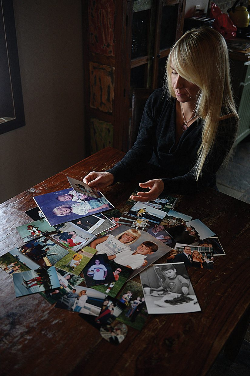 Mara Rhodes sorts through photographs of her brother, Mark, while completing a slideshow presentation for a four-part Lunch and Learn series: Drug & Heroin Awareness, Use and Affects and the Dangers of Pain Killers in our community. Rhodes' brother lost his life to an accidental opiate overdose in the fall of 2014.