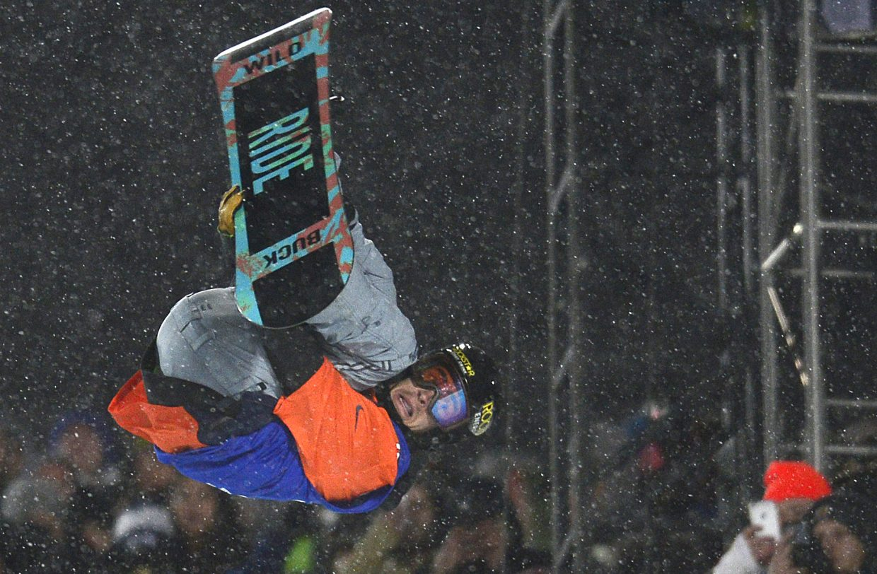 Matt Ladley flies through a trick Saturday. He only got one run as persistent snow shortened the men's superpipe competition at X Games, but it was a good one. He won the event, earning his first X Games medal.