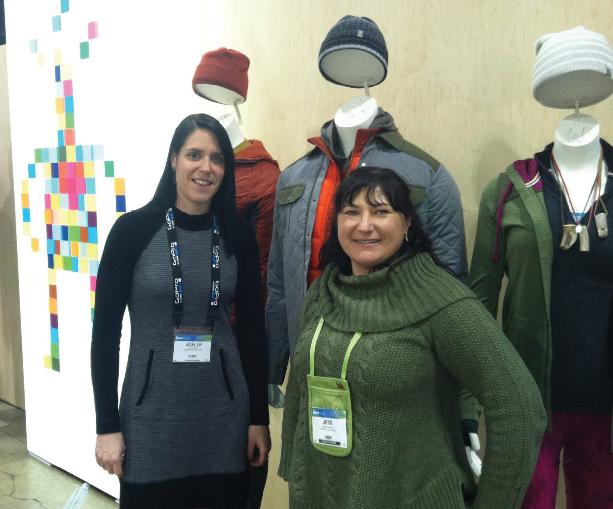 Smartwool employees Joelle Hamm and Jess Feinerman hawk socks at Denver's annual Snowsports Industries America Snow Show, which continues through today at the Colorado Convention Center.