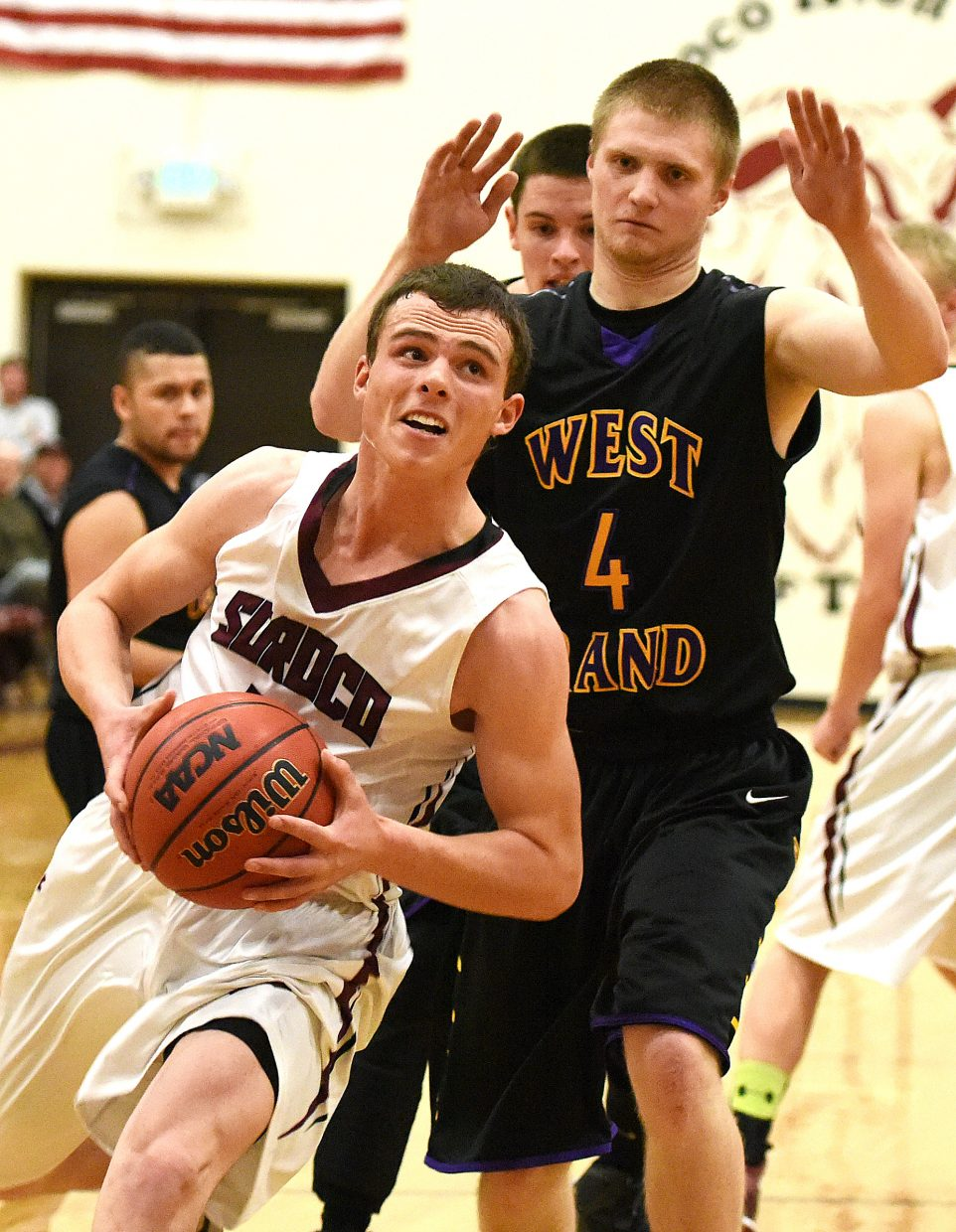 Eric Logan drives to the basket for Soroco on Saturday.