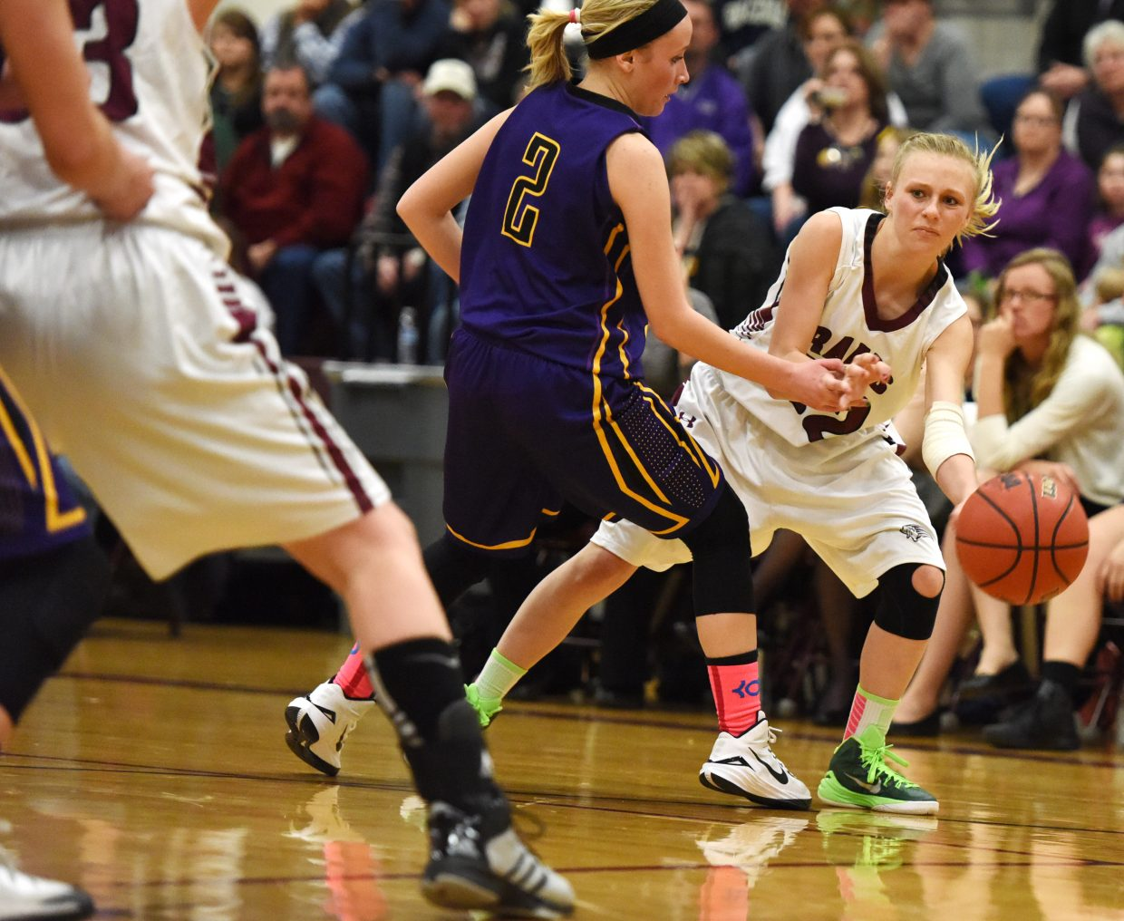Soroco's Morgan George tries to slip a pass into the paint Saturday.
