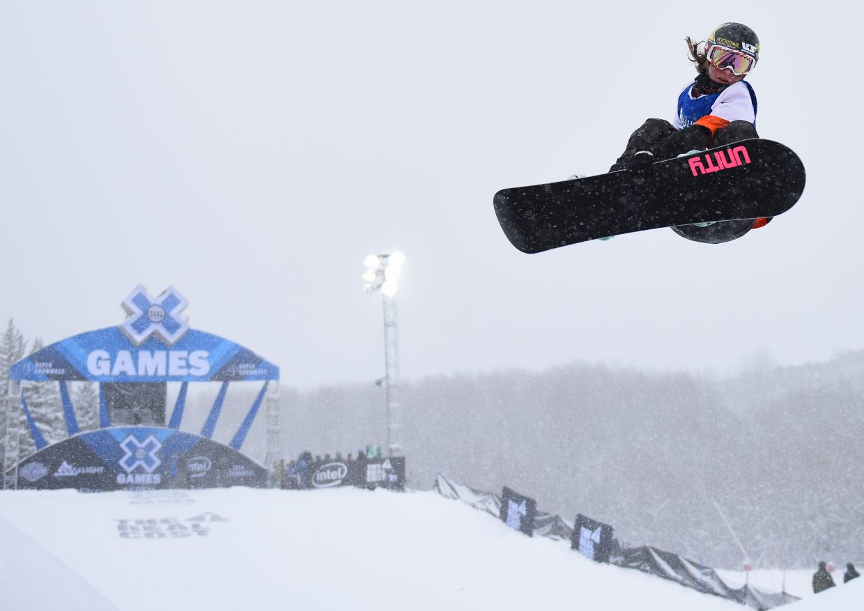 Steamboat Springs snowboarder Arielle Gold flies high above the half-pipe Sunday during the women's snowboard pipe competition at X Games in Aspen. Gold laid down a clean run on her first try and that proved good enough to net her a career-best X Games finish, second place.