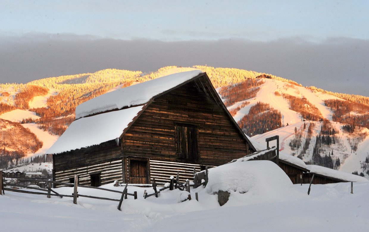 Mount Werner shines at sunset behind the famous More Barn. Snow returns to the forecast later this week.