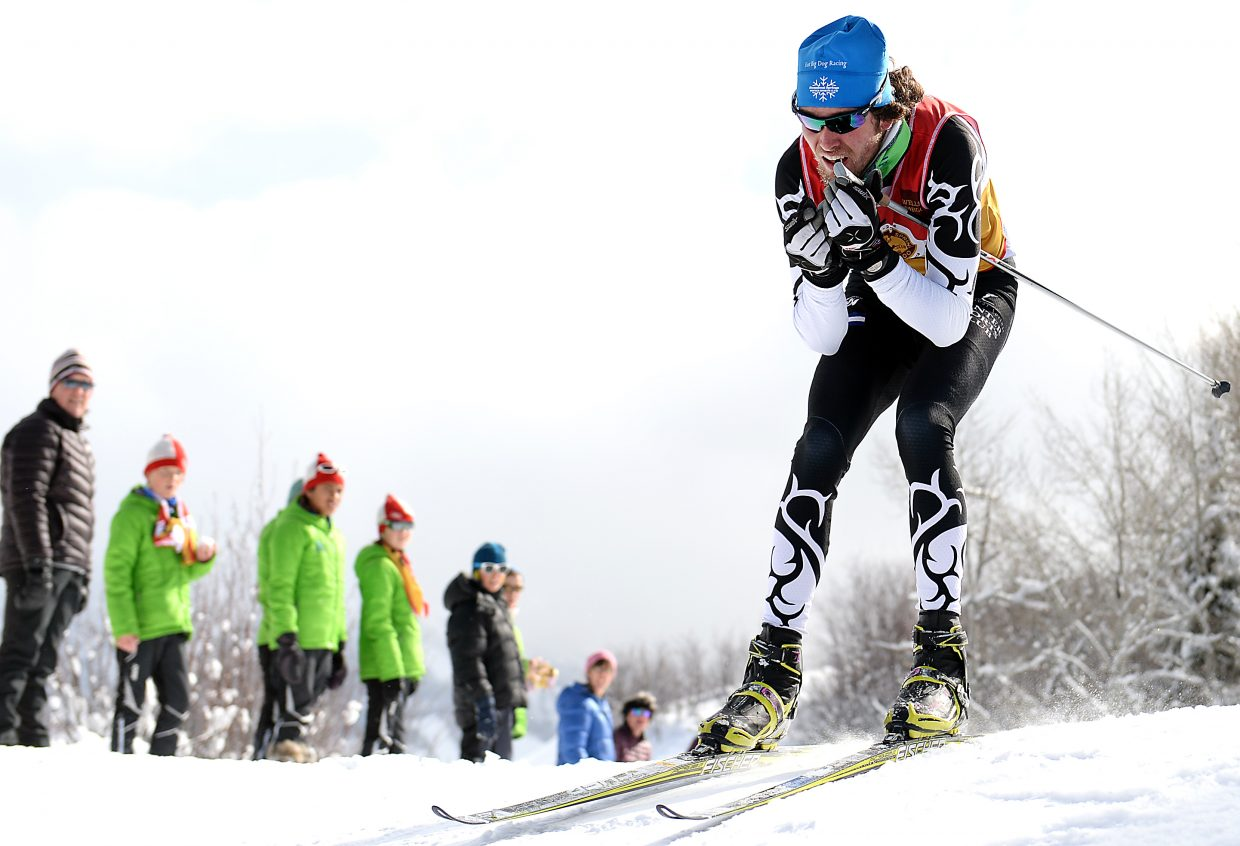 Evan Weinman comes over a hill Saturday during the U20 men's mass start Nordic skate ski race in Steamboat Springs.