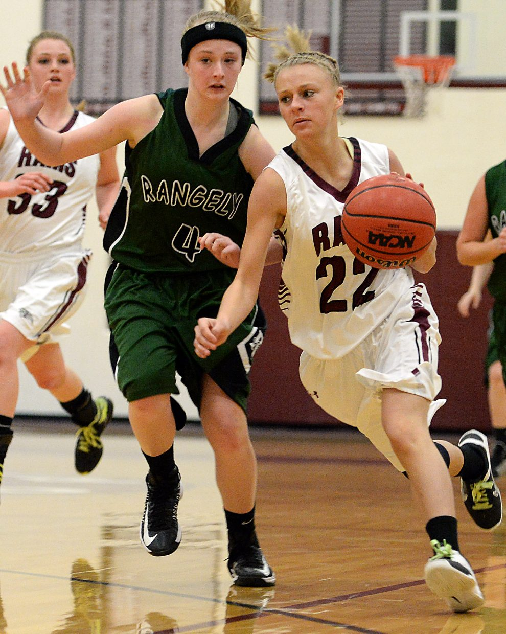 Soroco's Morgan George drives to the hoop Saturday as the Rams racked up a big win against Rangely.