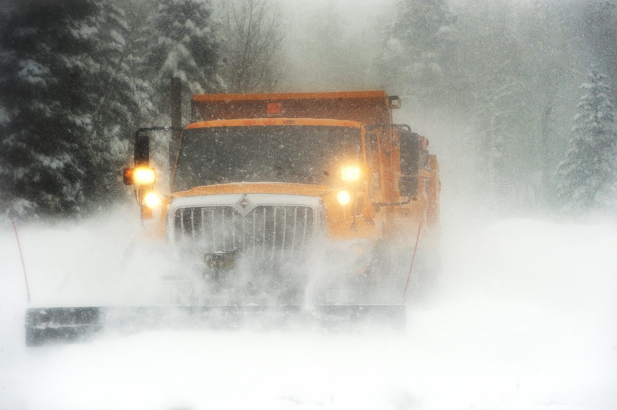A city sand truck plows snow off of Aspen Wood Drive in February, 2016.