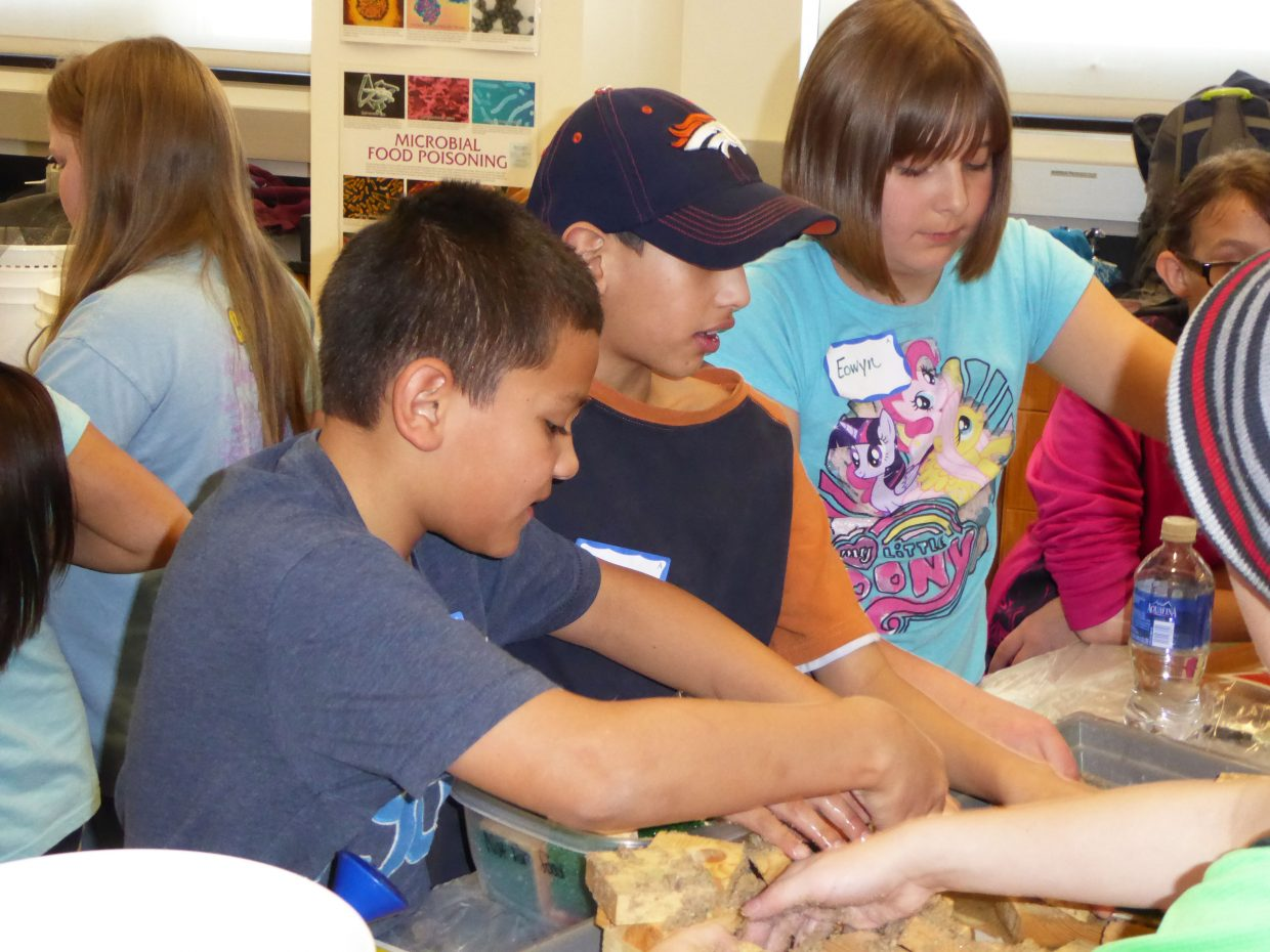 Sunset Elementary School Students Marcos Romero, left, Jonathan Lopez and Eowyn Phelps work on erosion experiments during the Exploring Physical Science STEM Workshop, run by the non-profit organization Science Discovery from the University of Colorado Boulder. Colorado Northwestern Community College hosted the workshop at its Craig campus.