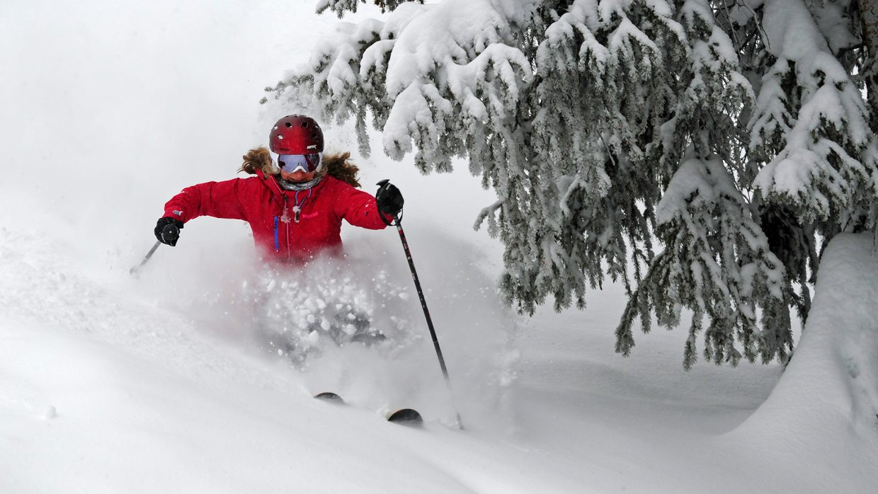 Audrey Williams finds untracked powder among the spruce trees at Steamboat Ski Area Jan. 25.