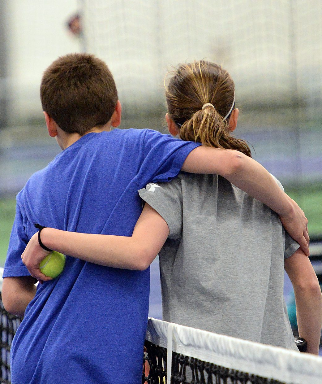 Teague and Tatum Burger hug Sunday after a tight match in Steamboat Springs.