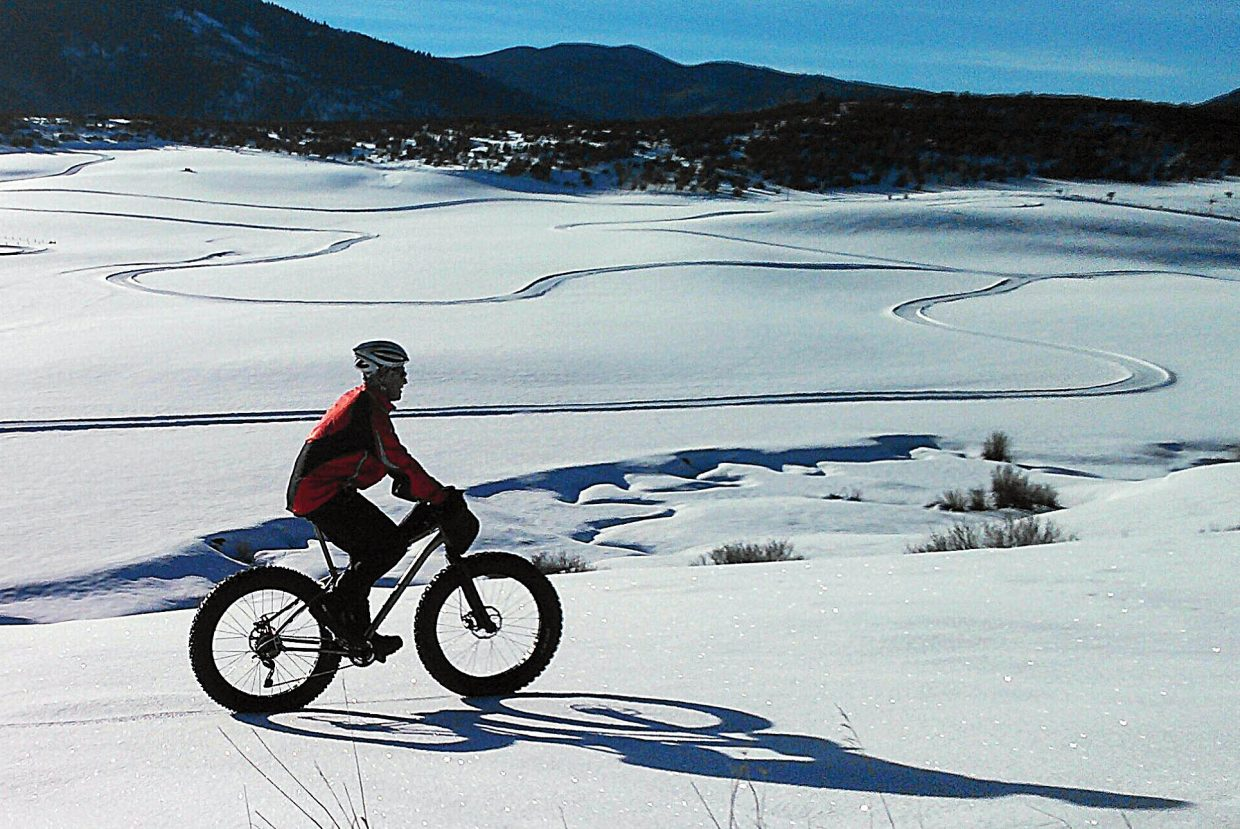 A cyclist at Lake Catamount uses a fat tire bike to make his way along the trail system. The Wednesday the Catamount Ranch & Club will host the first of two fat tire races in the Fat Cat Full Moon Snowbike Race series. Registration for the race will close at 5:30 p.m. Wednesday. For more information or to register for the event, call 970-871-667. Cost to register is $35. To sign up for both races, the fee is $75, which includes a Fat Cat hoodie.