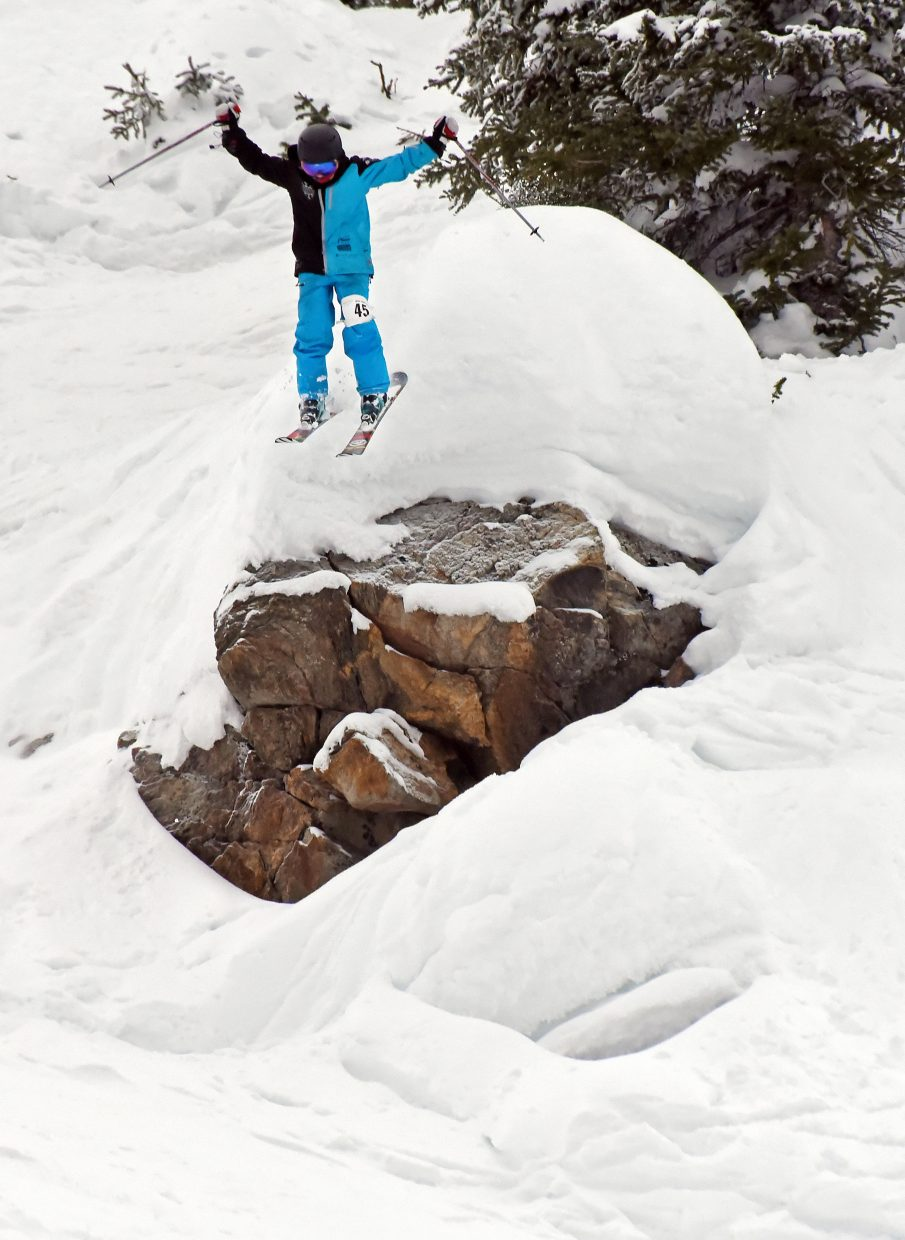 Logan Spiegel flies over a boulder Saturday during an IFSA big mountain ski event in Steamboat Springs.