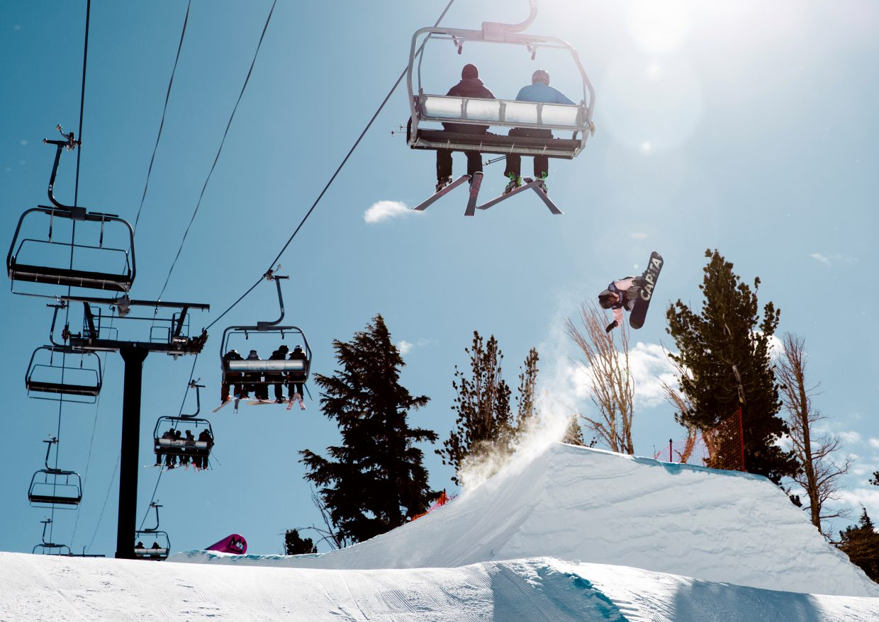 Nik Baden flies over a jump at Mammoth Mountain Resort in California on Wednesday during the qualification round for a U.S. Grand Prix event. The competition is the first snowboard slopestyle qualifier for the 2018 Winter Olympics.