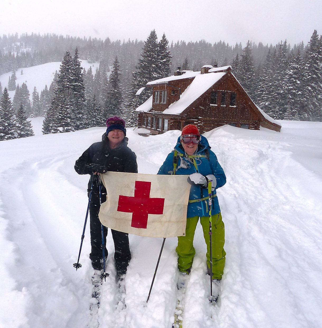 Nancy Kramer, left, and Deb Proper, of Steamboat Springs made their last trip to the Tenth Mountain Division Hut north of Leadville in January after 30 years of backcountry hut trips. The flag is symbolic of Kramer's father, Bill Robertson's, service in Italy in World War II as a medic in the Tenth Mountain Division.