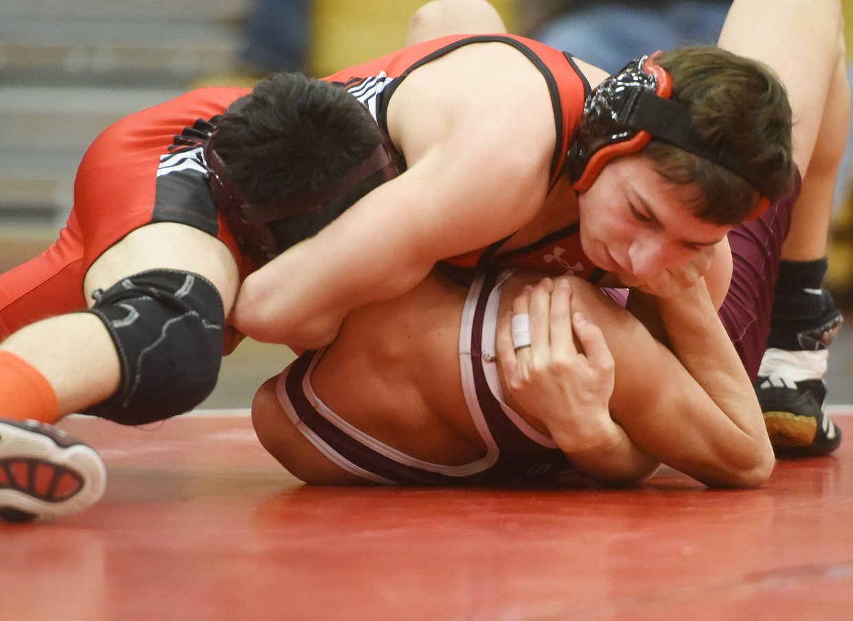 Colton Pasternak closes in on the pin Thursday during a wrestling triangular at Steamboat Springs High School. Steamboat went 11-1 in contested matches against Rifle and Palisade.