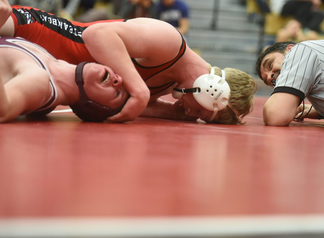 Steamboat's Hayden Johnson wrestles Thursday against Palisade. He went on to win the match.
