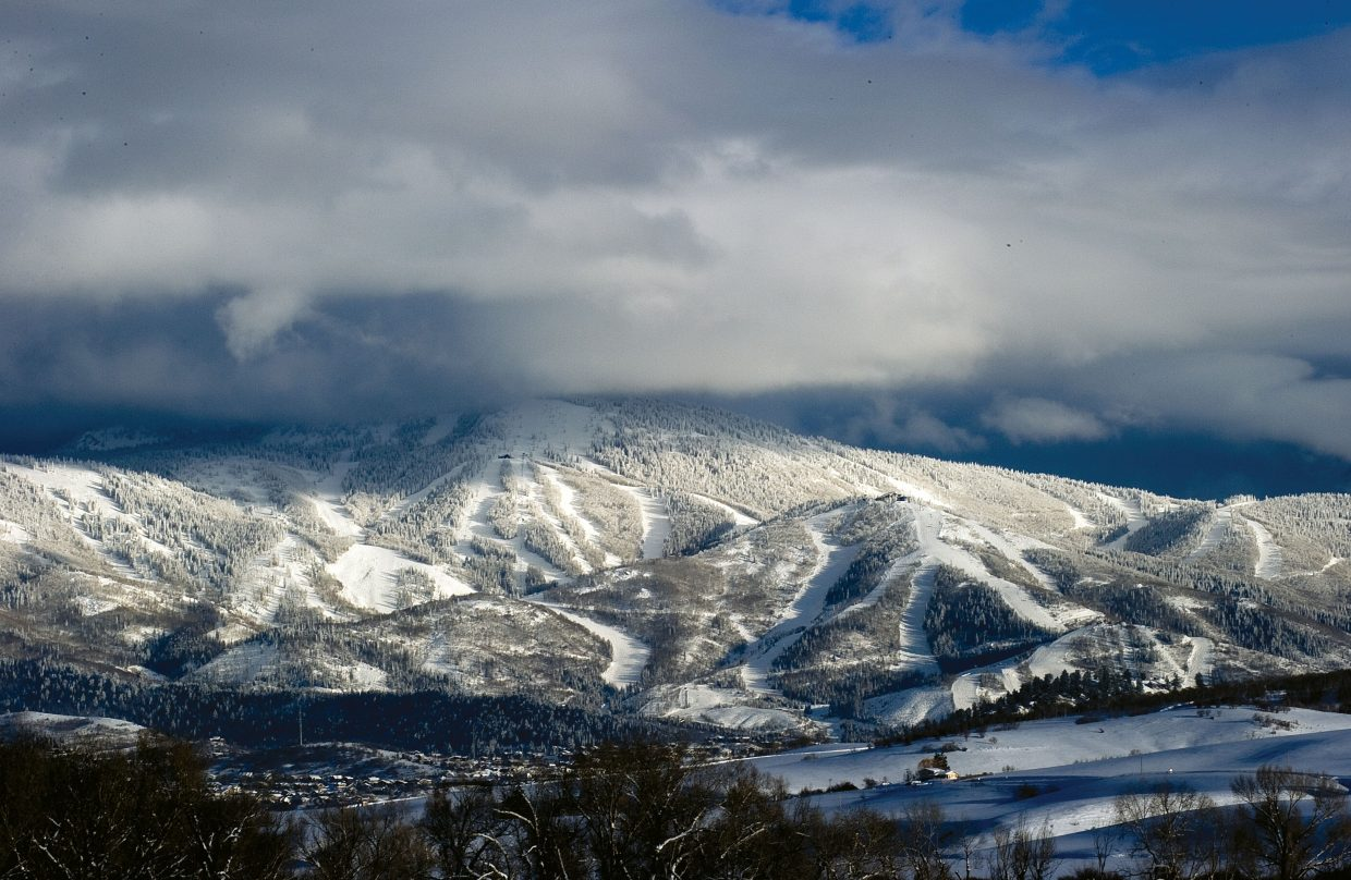 Clouds hang over the slopes of the Steamboat Ski Area.