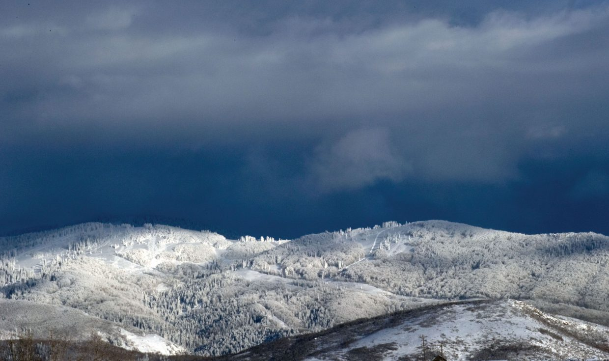 The last rays of sun fall on the snow-covered peaks that surround Steamboat Springs.
