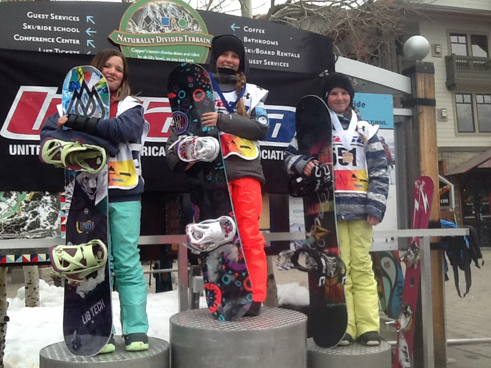 Rebecca Dillon, right, and Grace Drobek stand atop the podium during a banked slalom event at Copper Mountain.