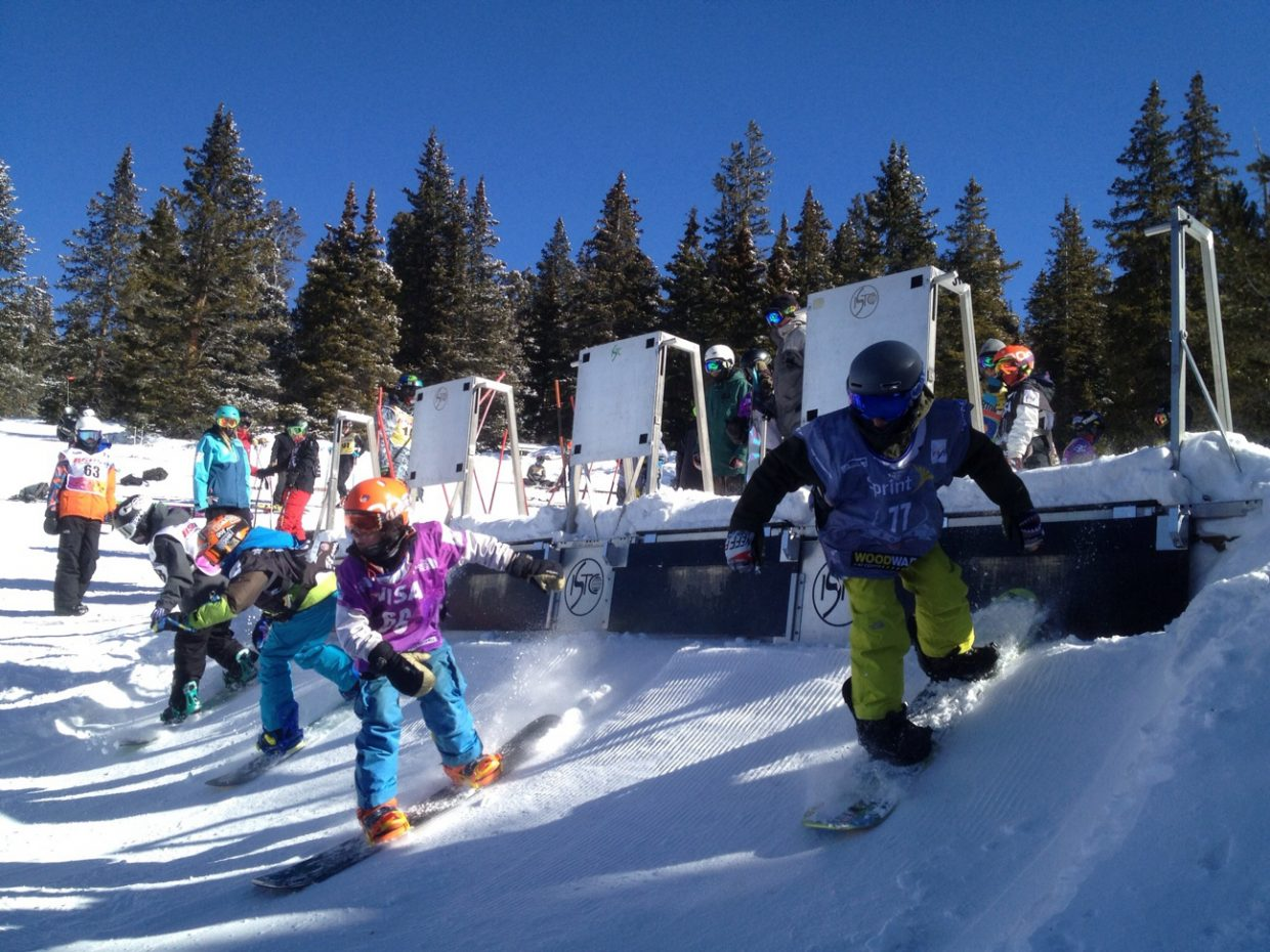 Jake Larsen, right, and Marty Boyd, second from right, jump out of the gate during a snowboard cross race last weekend at Ski Cooper.